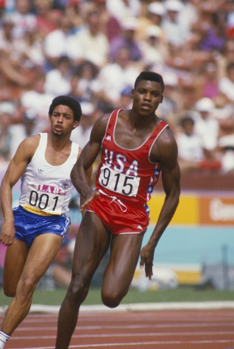 1984: Carl Lewis runs on the track during the Summer Olympics XXIII circa 1984 in Los Angeles, California.