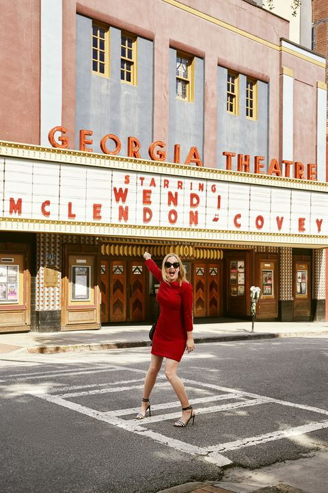 """<p>Wendi is ready to paint the town red with glam sunnies and strappy checkered sandals, because red is, well, red-hot this fall. Use it to pump up the volume on everything from a classic sheath dress to bold lips.</p><p><em><strong>Dress</strong>, $39, <a href=""""http://joefresh.com"""" target=""""_blank"""">joefresh.com</a>. <strong>Sunglasses</strong>, $22, <a href=""""http://fantas-eyes.com"""" target=""""_blank"""">fantas-eyes.com</a>. <strong>Cuff</strong>, Jenny Bird, $95, <a href=""""http://cameonouveau.com"""" target=""""_blank"""">cameonouveau.com</a> (20% off sitewide with code GHKSEPT20). <strong>Bag</strong>, $59, <a href=""""http://ninewest.com"""" target=""""_blank"""">ninewest.com</a>. <strong>Heels</strong>, $130, Marshalls stores.</em></p><p><em><strong>On location:</strong> <a href=""""http://www.georgiatheatre.com/"""" target=""""_blank"""">Georgia Theatre</a><br></em><em>Imagine your name in lights on the marquee of the 1889 Georgia Theatre in Athens, where you can catch live concerts, old-school movies and more.</em></p>"""