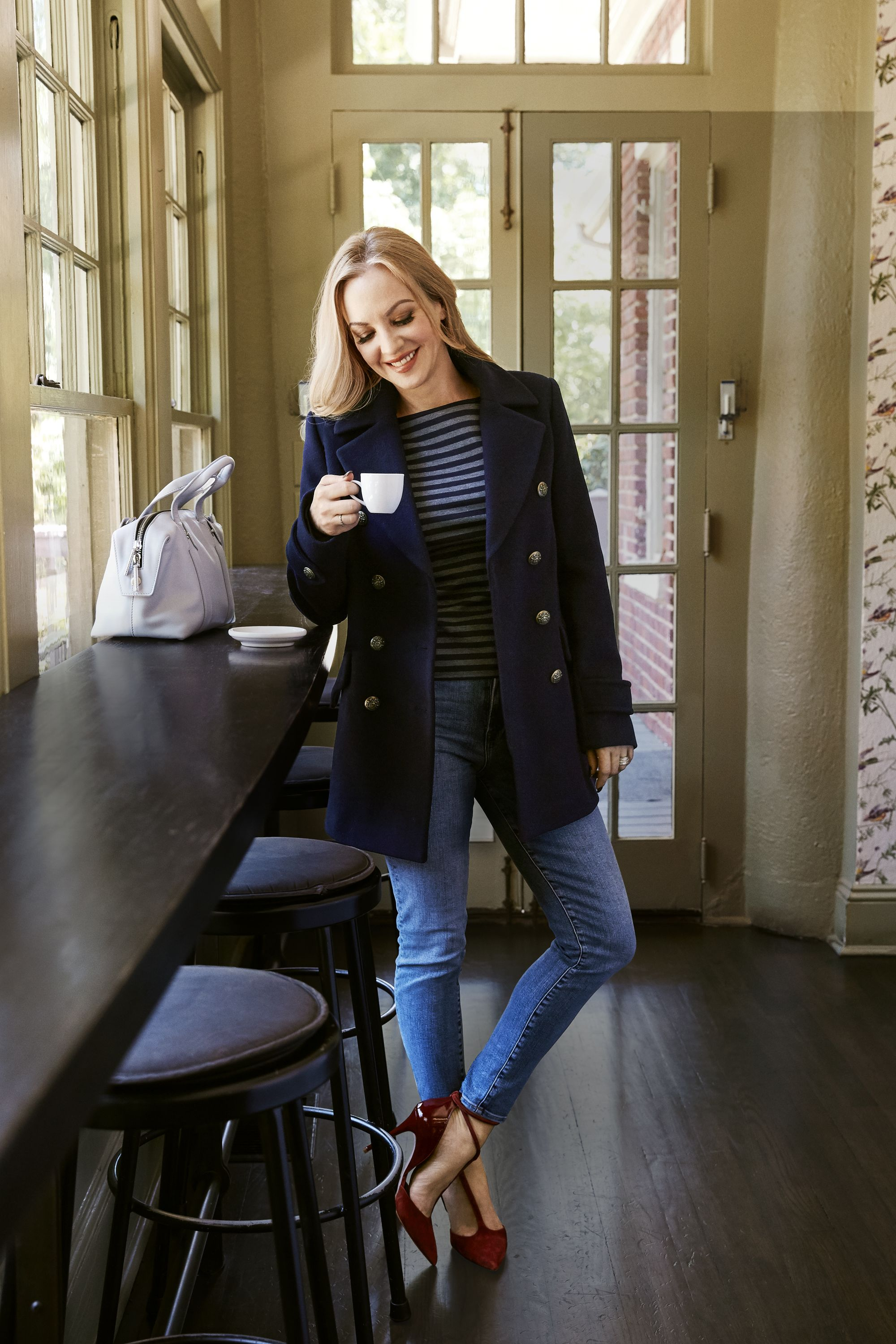 "<p>This nautical number never goes out of style. Stick to classic detailing, like brass buttons, and a shade of navy, black or gray to ensure that yours remains timeless. </p><p><em><strong>Coat</strong>, French Connection, $198, <a href=""http://nordstrom.com"" target=""_blank"">nordstrom.com</a>. <strong>Shirt</strong>, $60, <a href=""http://thelimited.com"" target=""_blank"">thelimited.com</a>. <strong>Jeans</strong>, $35, <a href=""http://oldnavy.com"" target=""_blank"">oldnavy.com</a>. <strong>Ring</strong>, $65, <a href=""http://pandora.net"" target=""_blank"">pandora.net</a>. <strong>Ring</strong> (left hand throughout), Wendi's own. <strong>Heels</strong>, $295, <a href=""http://reiss.com"" target=""_blank"">reiss.com</a>. <strong>Bag</strong>, Flynn, $450, <a href=""http://urbanoutfitters.com"" target=""_blank"">urbanoutfitters.com</a>.</em> </p><p><em><strong>On location:</strong> <a href=""http://fiveandten.com/"" target=""_blank"">5&10</a><br></em><em>Duck into 5&10 for a cup of joe or a cocktail. Yes, the hip spot serves up both, along with eats by James Beard Award–winning chef Hugh Acheson.</em></p>"