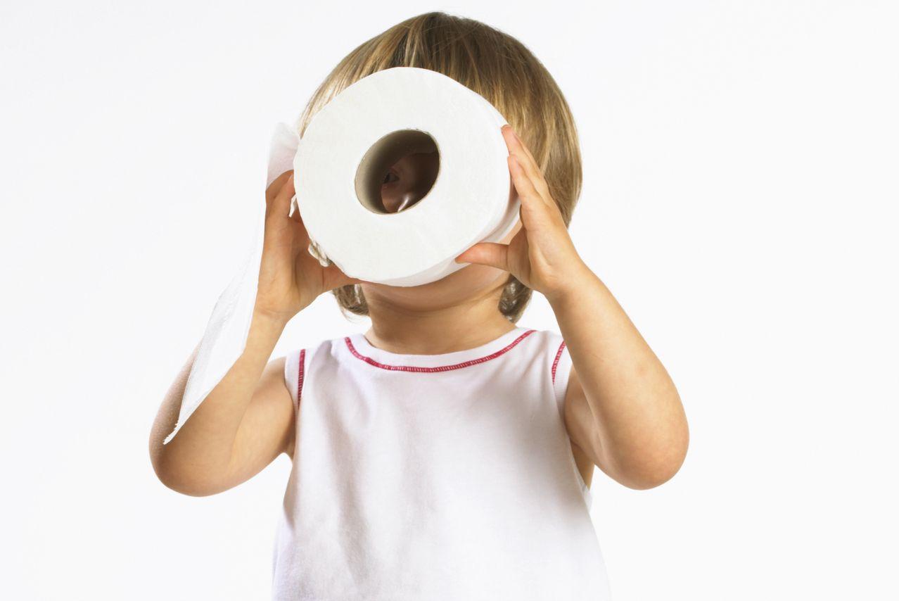kid looking through toilet paper