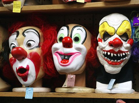 Performing arts, Entertainment, Jaw, Tooth, Clown, Laugh, Shelving, Comedy, Fictional character, Sculpture,