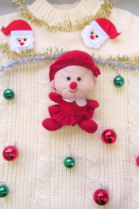 Red, Textile, Fictional character, Christmas, Costume accessory, Christmas decoration, Toy, Pattern, Holiday, Christmas eve,