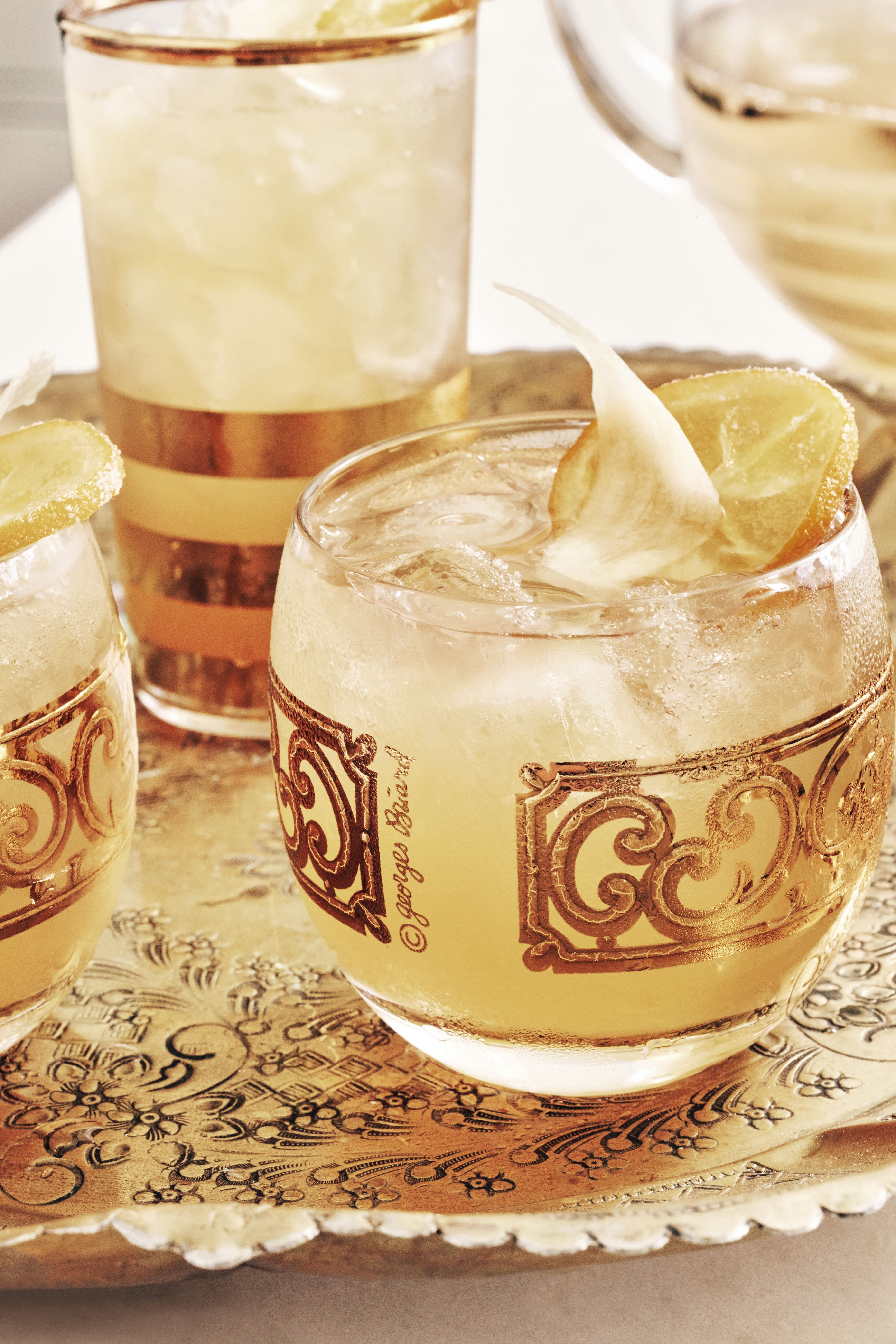 """<p>Toast the holidays with your&nbsp&#x3B;favorite punch or cocktail served&nbsp&#x3B;in pretty vintage glassware.</p><p><a href=""""http://www.goodhousekeeping.com/best-ginger-bee-sting-recipe"""" target=""""_blank"""" data-tracking-id=""""recirc-text-link""""><em data-redactor-tag=""""em"""" data-verified=""""redactor"""" data-tracking-id=""""recirc-text-link"""">Get the recipe here&nbsp&#x3B;»</em></a><span class=""""redactor-invisible-space""""><em data-redactor-tag=""""em"""" data-verified=""""redactor""""><a href=""""http://www.goodhousekeeping.com/""""></a></em></span><span class=""""redactor-invisible-space""""></span><br></p>"""