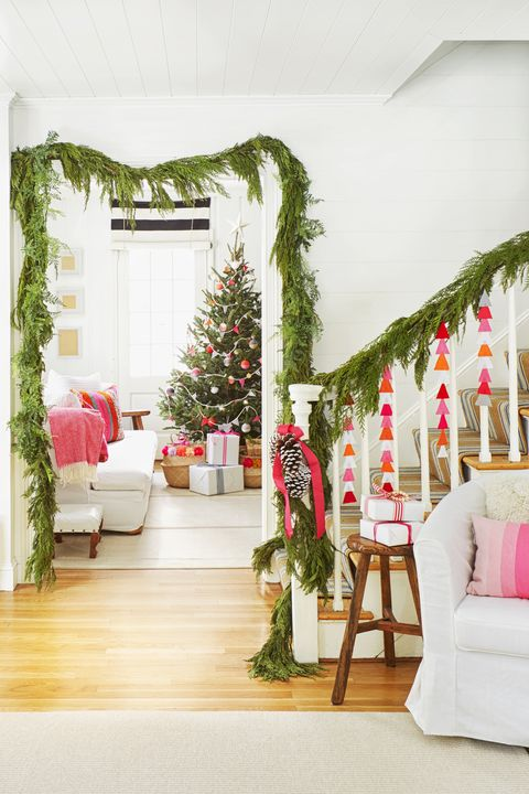 Pink Christmas accents in a cheerful holiday decorated home - Good Housekeeping. Whimsical Holiday Decor Inspiration, Ideas & Christmas Decorating Finds!