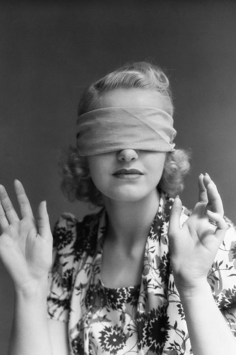 black and white photo of woman in blindfold