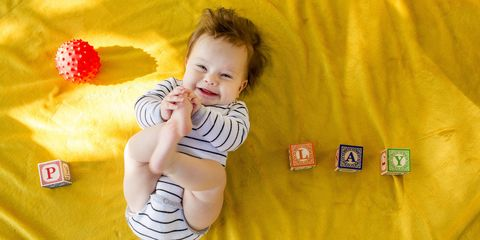 Finger, Product, Yellow, Child, Happy, Facial expression, Baby & toddler clothing, Toddler, Baby, Thumb,