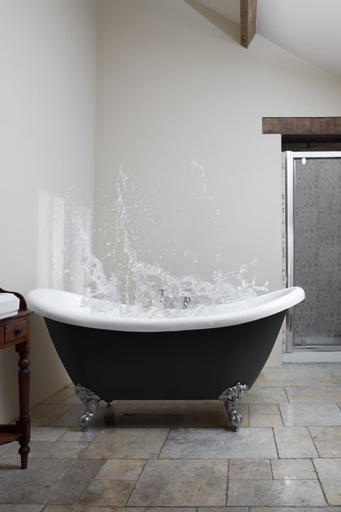 bathtub with water splashing up