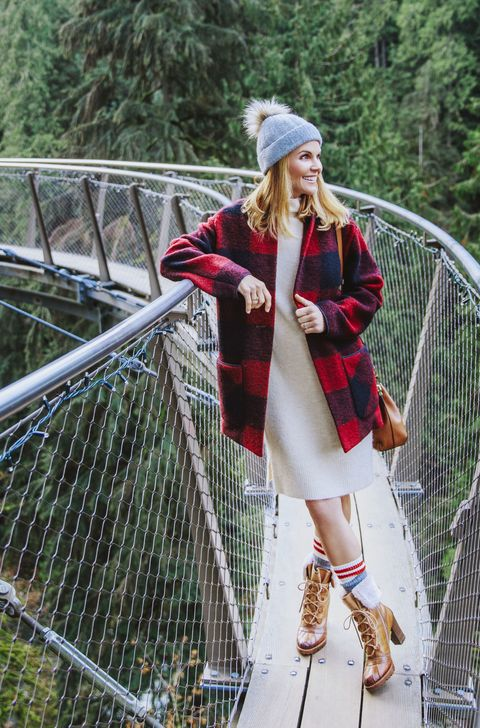 "<p>Cozy up in buffalo checks, lug-soled boots or other things fit for a log cabin.</p><p><em data-redactor-tag=""em"" data-verified=""redactor""><strong data-redactor-tag=""strong"" data-verified=""redactor"">Sweater coat, </strong>$250, <strong data-redactor-tag=""strong"" data-verified=""redactor"">dress, </strong>$98, and <strong data-redactor-tag=""strong"" data-verified=""redactor"">hat</strong><strong data-redactor-tag=""strong"" data-verified=""redactor"">, </strong>$45, <a href=""http://www.aritzia.com"" target=""_blank"" data-tracking-id=""recirc-text-link"">aritzia.com</a>. <strong data-redactor-tag=""strong"" data-verified=""redactor"">Ring,</strong> $10, <a href=""http://www.charmingcharlie.com"" target=""_blank"" data-tracking-id=""recirc-text-link"">charmingcharlie.com</a>. <strong data-redactor-tag=""strong"" data-verified=""redactor"">Ring (worn throughout on left hand), </strong>Lori's own. <strong data-redactor-tag=""strong"" data-verified=""redactor"">Purse,</strong> $225, <a href=""http://www.aritzia.com/"" target=""_blank"" data-tracking-id=""recirc-text-link"">aritzia.com</a><span class=""redactor-invisible-space"" data-verified=""redactor"" data-redactor-tag=""span"" data-redactor-class=""redactor-invisible-space""></span>. <strong data-redactor-tag=""strong"" data-verified=""redactor"">Socks (similar), </strong><a href=""http://www.roots.com"" target=""_blank"" data-tracking-id=""recirc-text-link"">roots.com</a></em><em data-redactor-tag=""em"" data-verified=""redactor"">. <strong data-redactor-tag=""strong"" data-verified=""redactor"">Boots,</strong> $250, <a href=""http://pikolinos.com"" target=""_blank"" data-tracking-id=""recirc-text-link"">pikolinos.com</a>.</em></p><p><strong data-redactor-tag=""strong"" data-verified=""redactor"">TRAVEL TIP: </strong>Walk among the treetops at the <a href=""http://www.capbridge.com"" target=""_blank"" data-tracking-id=""recirc-text-link"">Cliffwalk</a>, a series of winding walkways set 300 feet above the Capilano River. </p>"