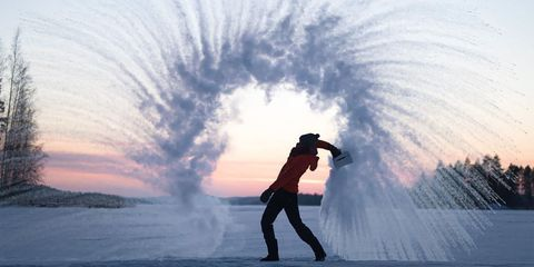 See how photographers are capturing photos of boiling water flying into the cold air.