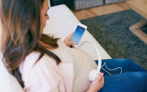 Pregnant Woman Using Headphones