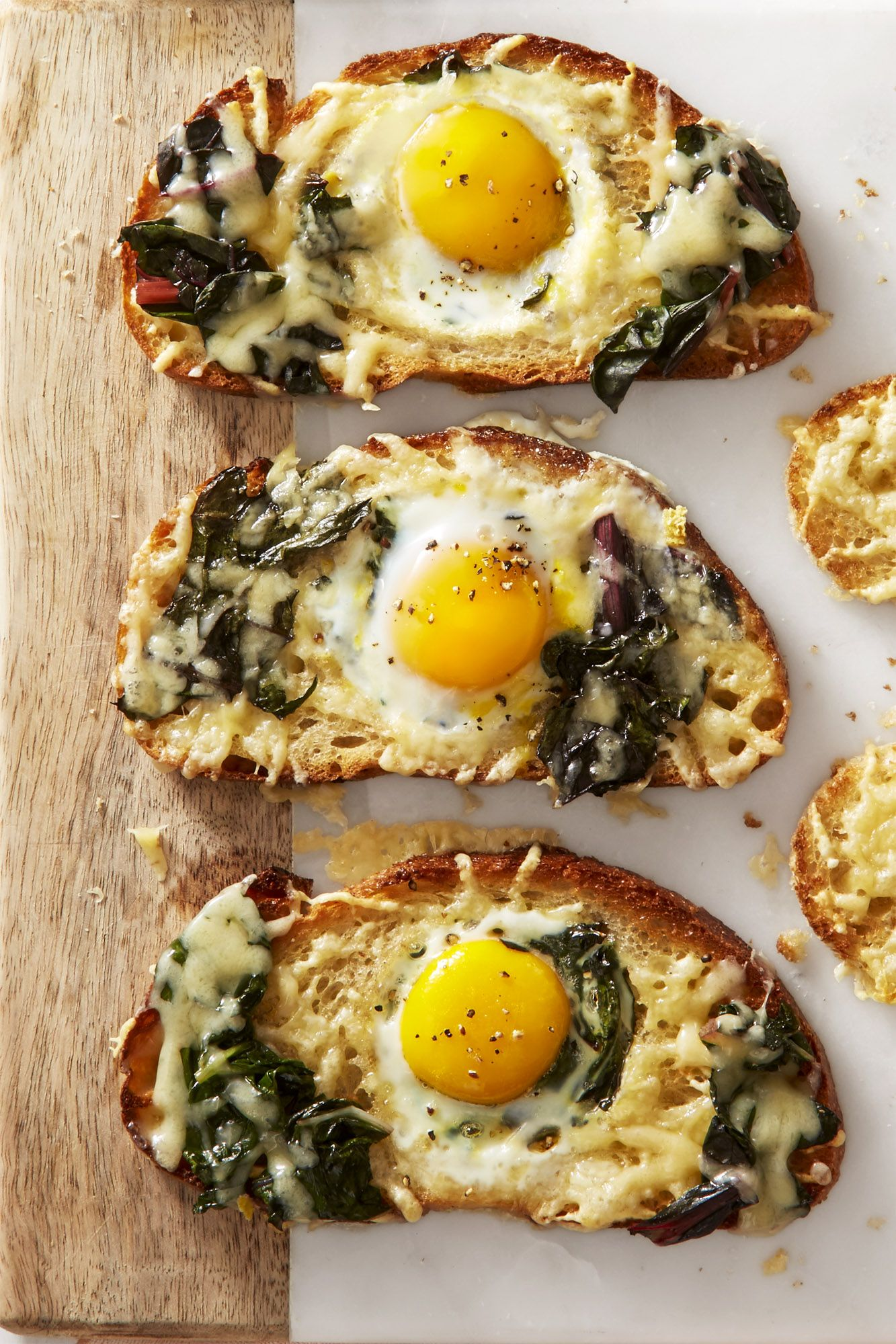 chard and gruyere eggs in a hole