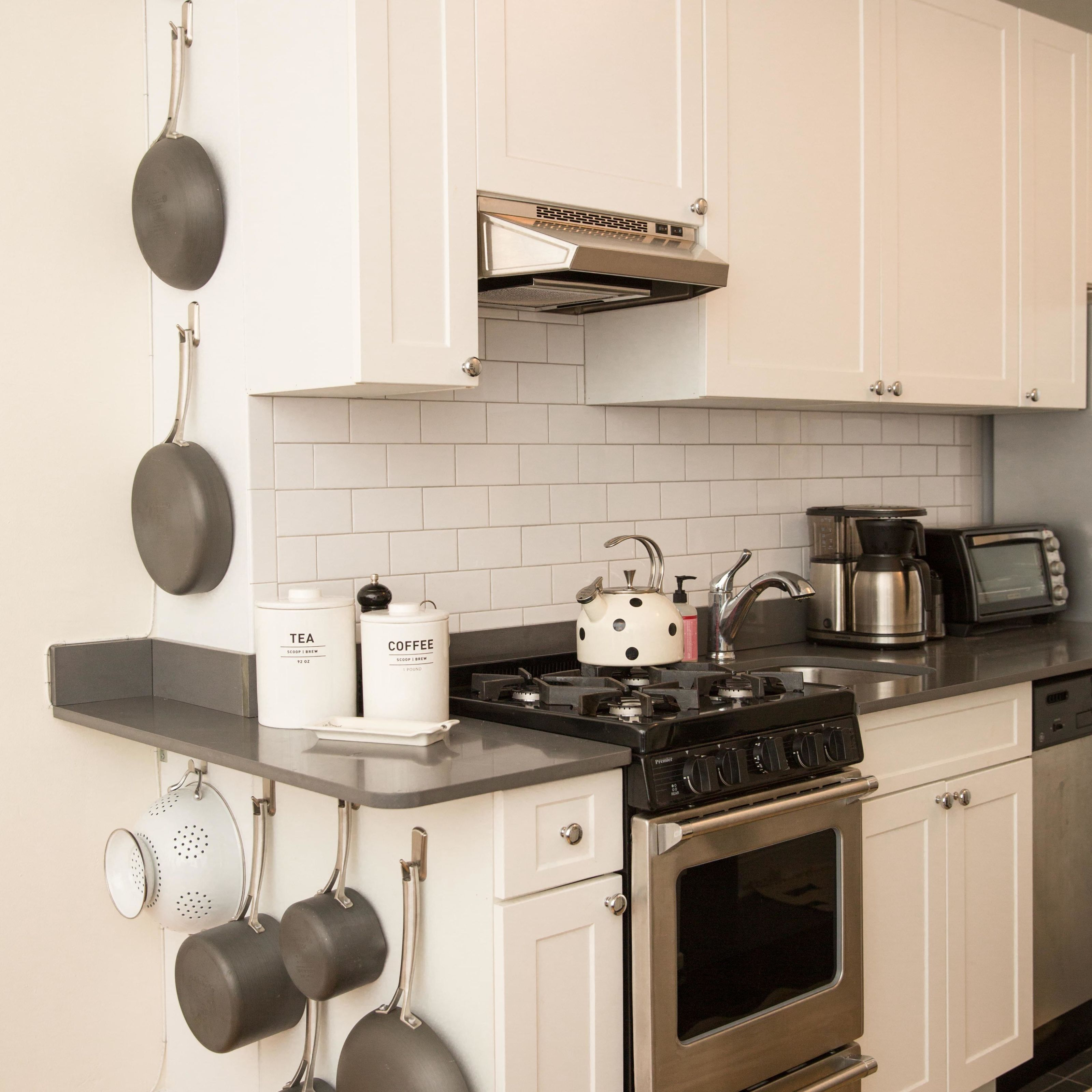 how to organize pots and pans smart ways to organize cooking tools rh goodhousekeeping com