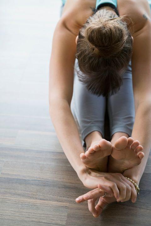 Yoga, Physical fitness, Sitting, Sportswear, Skin, Arm, Hand, Leg, Joint, Knee,
