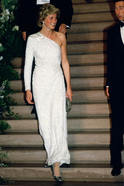 the princess of wales 1961   1997, later diana, princess of wales at a gala dinner at the national gallery in washington dc, 11th november 1985 she is wearing a white, crystal beaded silk chiffon assymetric gown by japanese designer hachi photo by tim grahamgetty images