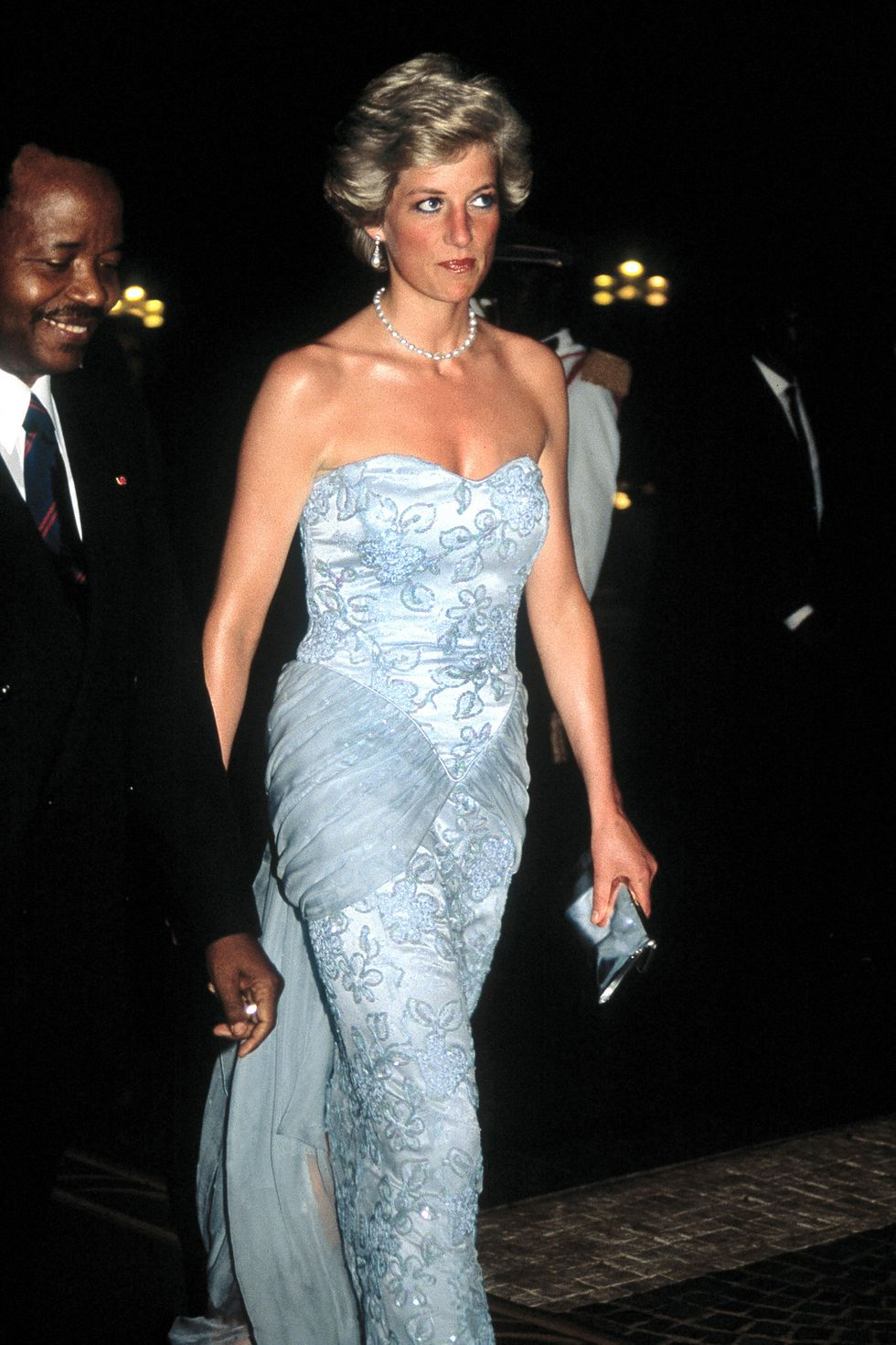 The Princess of Wales arrives at a presidential banquet held in Douala, Cameroon, March 1990. She wears a Catherine Walker dress. (Photo by Jayne Fincher/Princess Diana Archive/Getty Images)