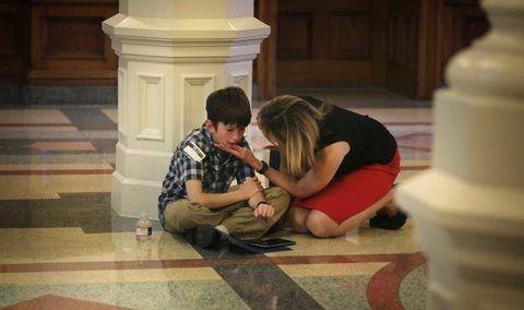 Amber Briggle comforting her transgender son, Max
