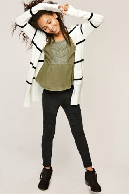 Clothing, White, Shoulder, Fashion model, Joint, Waist, Leggings, Fashion, Outerwear, Sleeve,