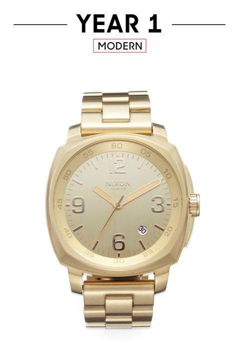 Watch, Analog watch, Watch accessory, Fashion accessory, Strap, Jewellery, Brand, Gold, Font, Material property,