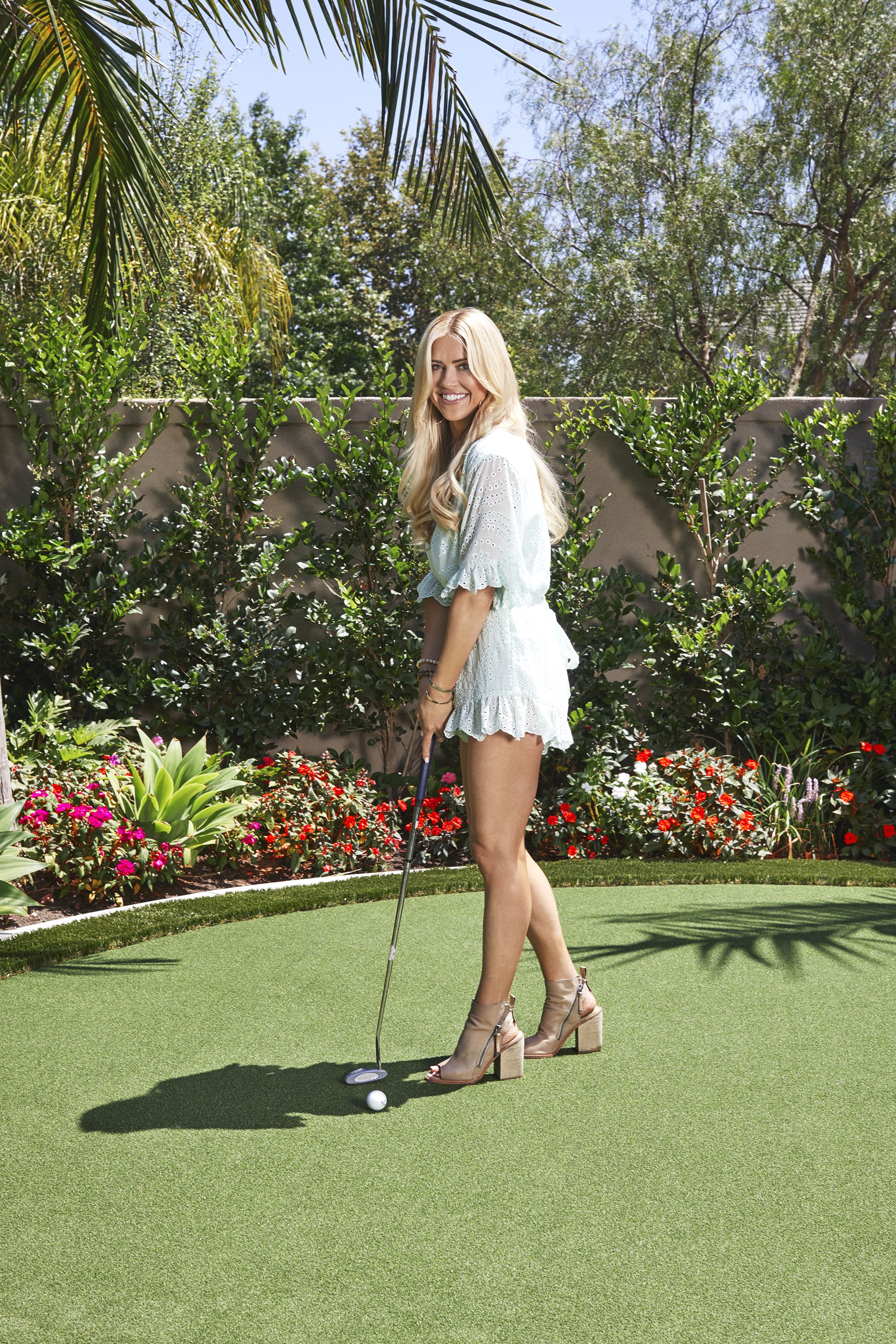Christina in her backyard, which features a small putting green, in Yorba  Linda, California.