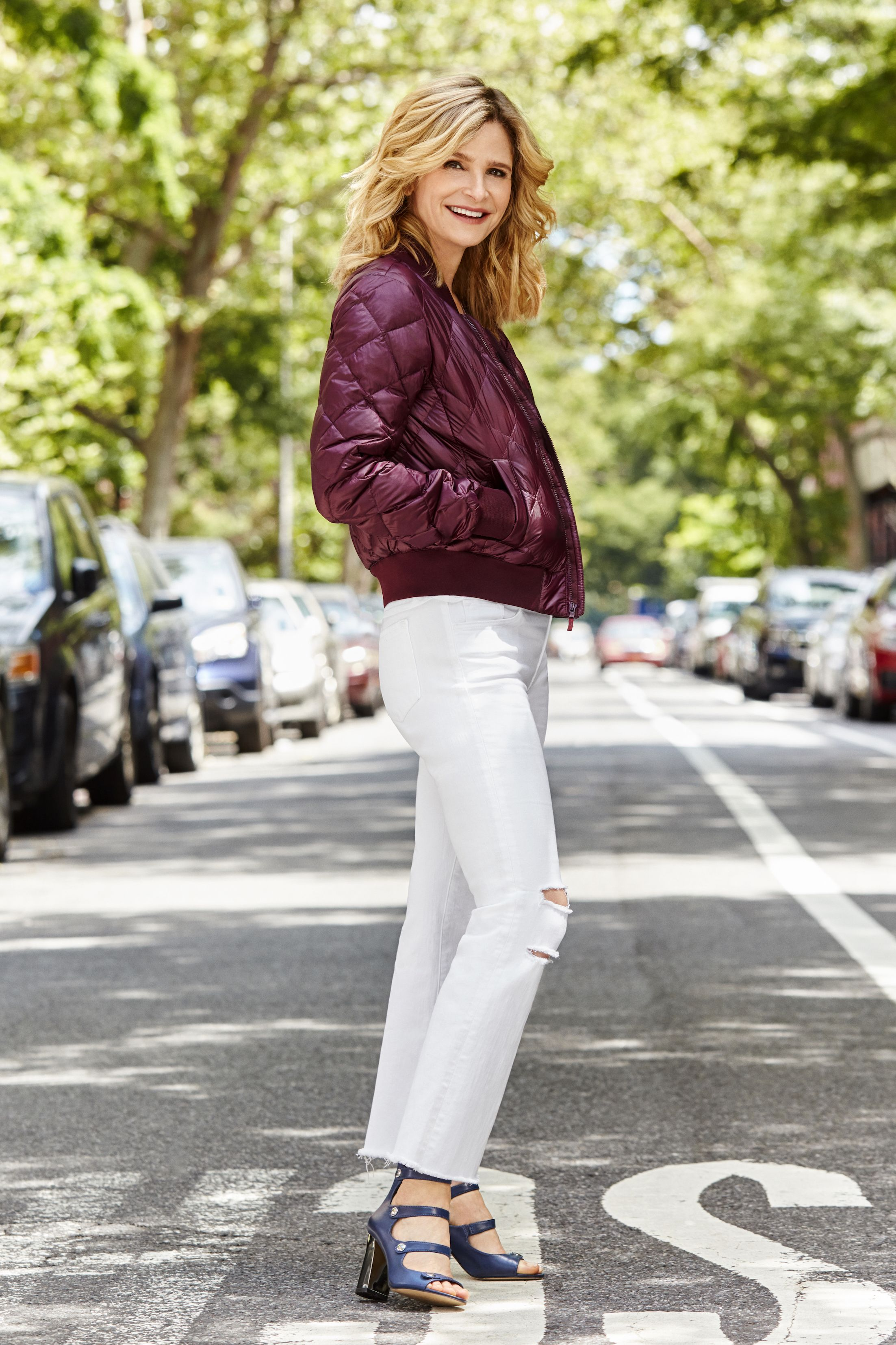 """<p>Add warmth and cool factor to your outfit with a layer that combines&nbsp&#x3B;<span>the coziness of a down jacket and the sleekness of a bomber.</span></p><p><span><em data-redactor-tag=""""em"""" data-verified=""""redactor"""">TNA for Aritzia <strong data-redactor-tag=""""strong"""" data-verified=""""redactor"""">jacket,</strong> $85, <a href=""""http://www.aritzia.com"""" target=""""_blank"""" data-tracking-id=""""recirc-text-link"""">aritzia.com</a>. <strong data-redactor-tag=""""strong"""" data-verified=""""redactor"""">Jeans, </strong>$188, <a href=""""http://jbrandjeans.com"""" target=""""_blank"""" data-tracking-id=""""recirc-text-link"""">jbrandjeans.com</a>. <strong data-redactor-tag=""""strong"""" data-verified=""""redactor"""">Heels,</strong> $89, <a href=""""http://www.marcfisherfootwear.com"""" target=""""_blank"""" data-tracking-id=""""recirc-text-link"""">marcfisherfootwear.com</a>.&nbsp&#x3B;</em></span></p><p><span><strong data-redactor-tag=""""strong"""" data-verified=""""redactor"""">BEAUTY TIP:</strong><em data-redactor-tag=""""em"""" data-verified=""""redactor"""">&nbsp&#x3B;</em></span><span>Ask your colorist&nbsp&#x3B;</span><span>to add slightly lighter&nbsp&#x3B;</span><span>highlights to the&nbsp&#x3B;</span><span>strands framing your&nbsp&#x3B;</span><span>face to illuminate&nbsp&#x3B;</span><span>your skin, à la Kyra.</span></p>"""