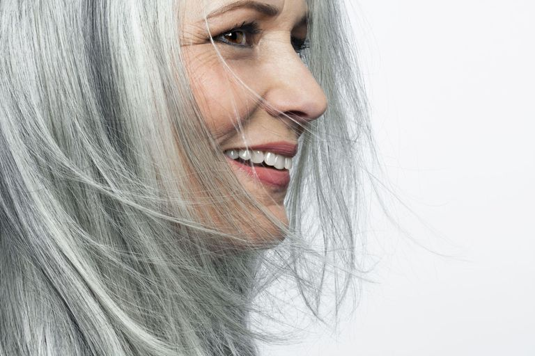 How to go gray tips for transitioning to gray hair getty imagesandreas kuehn solutioingenieria Gallery