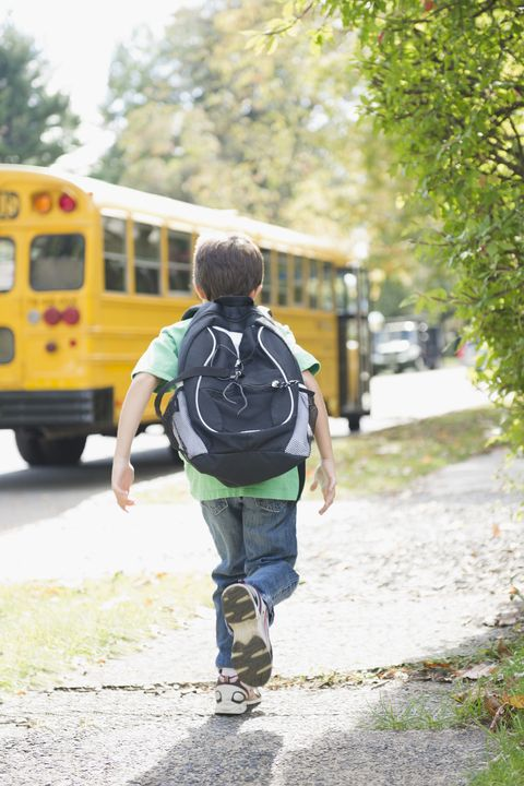 boy running to school bus