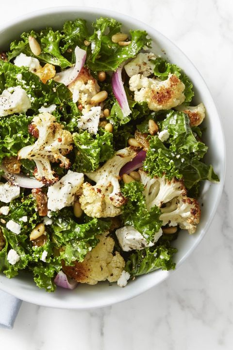 This kale and roasted cauliflower salad is brought to life with pine nuts, golden raisins, feta cheese and a drizzle of lemon juice.