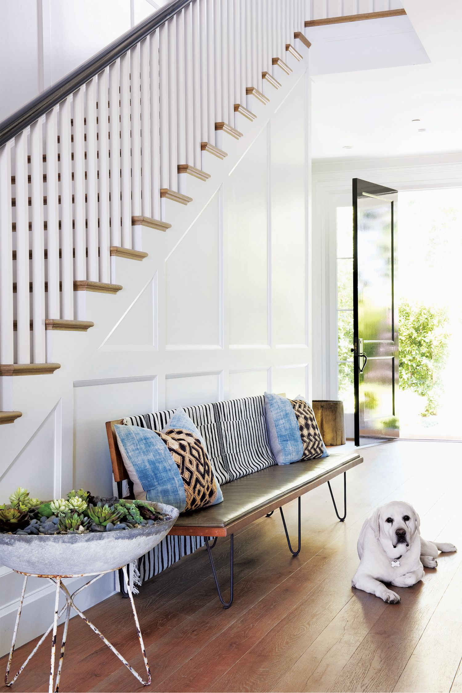"""<p>In place of a side table, accent an entryway with low-maintenance greenery like succulents in a pretty pot or raised planter.</p><p><em data-redactor-tag=""""em"""" data-verified=""""redactor"""">JF Chen <strong data-redactor-tag=""""strong"""" data-verified=""""redactor"""">bench,</strong> <a href=""""http://www.jfchen.com"""" target=""""_blank"""" data-tracking-id=""""recirc-text-link"""">jfchen.com</a>. Plant <strong data-redactor-tag=""""strong"""" data-verified=""""redactor"""">stand,</strong> <a href=""""http://www.orangefurniture.com"""" target=""""_blank"""" data-tracking-id=""""recirc-text-link"""">orangefurniture.com</a>. For similar: Happy Habitat cotton <strong data-redactor-tag=""""strong"""" data-verified=""""redactor"""">throw,</strong> $160, <a href=""""http://www.westelm.com"""" target=""""_blank"""" data-tracking-id=""""recirc-text-link"""">westelm.com</a>.</em><span class=""""redactor-invisible-space""""><em data-redactor-tag=""""em"""" data-verified=""""redactor""""></em></span><br></p>"""