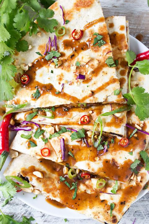 "<p>Your typical <a href=""http://www.goodhousekeeping.com/food-recipes/easy/g4254/enchiladas/"" target=""_blank"" data-tracking-id=""recirc-text-link"">Mexican staple</a> gets a Thai upgrade in this unique dish, and it's even tastier than you can imagine.</p><p><a href=""http://www.thechunkychef.com/thai-peanut-chicken-quesadillas/"" target=""_blank"" data-tracking-id=""recirc-text-link""><em data-redactor-tag=""em"" data-verified=""redactor"">Get the recipe from The Chunky Chef »</em></a></p>"
