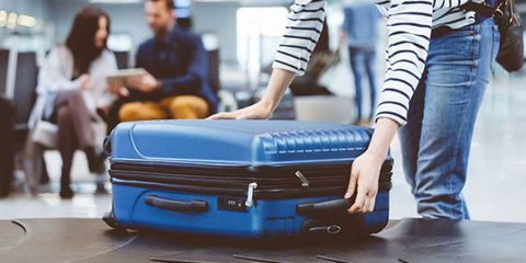 Blue, Baggage, Suitcase, Hand luggage, Joint, Footwear, Luggage and bags, Bag, Hand, Fashion accessory,