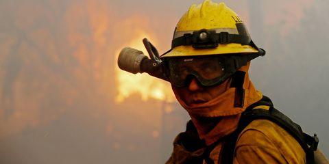 Firefighter, Yellow, Personal protective equipment, Hard hat, Helmet, Headgear, Hat, Landscape,