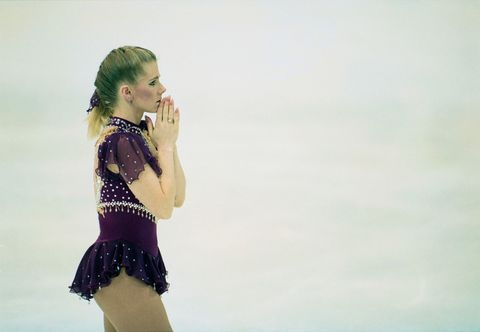 Ice skating, Yellow, Recreation, Skating, Figure skating, Leg, Photography, Ice dancing, Thigh, Performance,