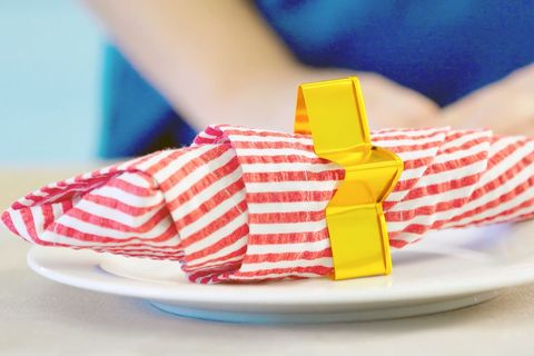 Yellow, Food, Paper, Paper product, Play, Tableware, Shoe,
