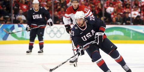 Sports, Sports gear, Hockey protective equipment, Ice hockey, Tournament, College ice hockey, Sports equipment, Team sport, Hockey pants, Ball game,
