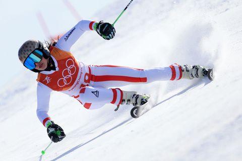 Sports, Skier, Alpine skiing, Skiing, Winter sport, Ski boot, Ski pole, Recreation, Freestyle skiing, Individual sports,