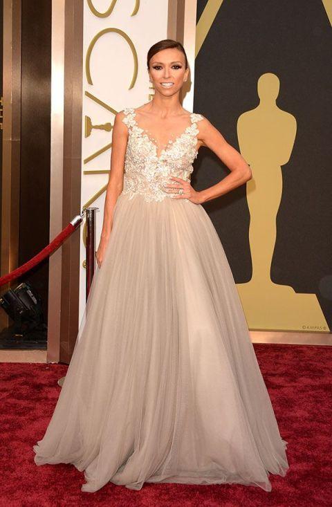Gown, Dress, Carpet, Red carpet, Clothing, Wedding dress, Flooring, Bridal party dress, Fashion model, Shoulder,