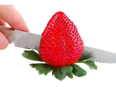 slicing a strawberry