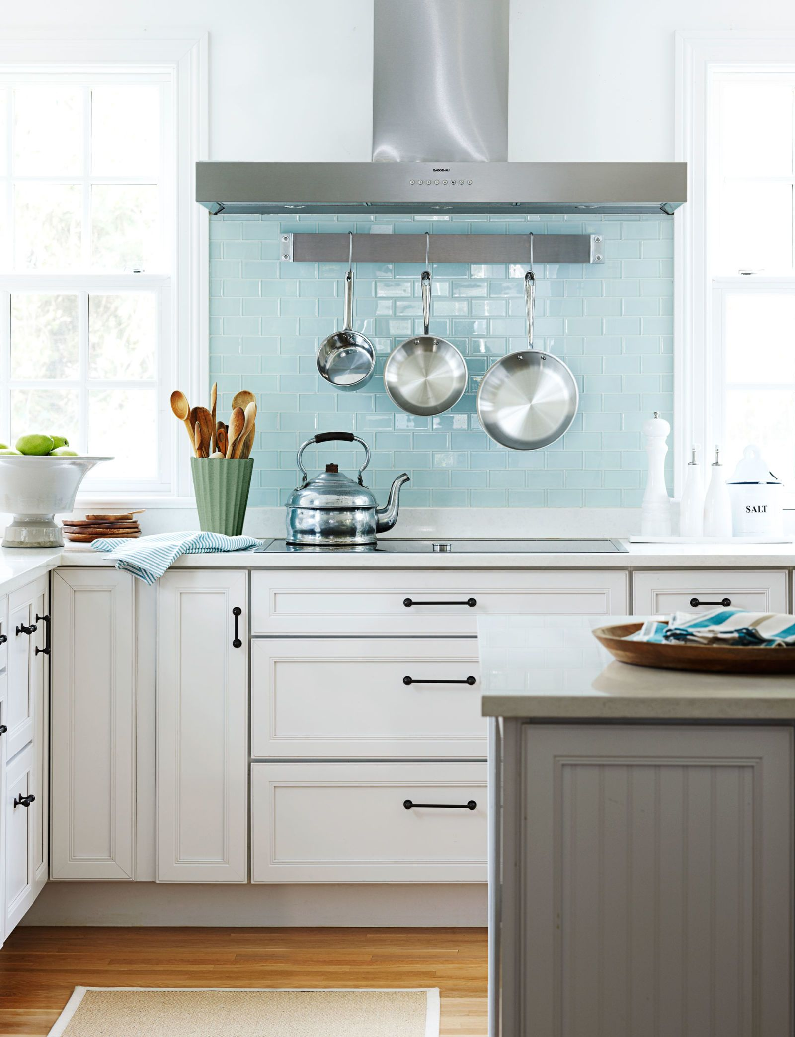 kitchen stove with pans hanging