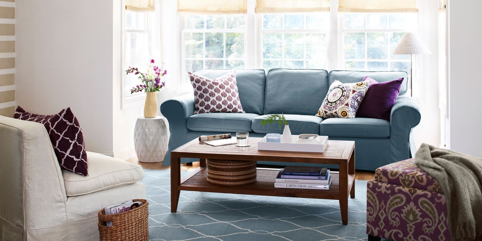 Lovely Blue Couch With Throw Pillows And Coffee Table In Living Room