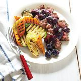 rosemary rubbed strip steak with blackberry sauce