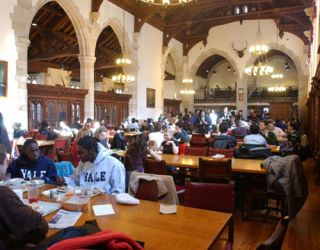 students eating at berkeley college dining hall yale university