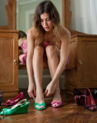 woman putting on shoes