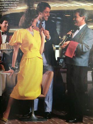 Leg, Microphone, Formal wear, Dress, Suit trousers, Song, Conversation, One-piece garment, Trumpeter, Cocktail dress,