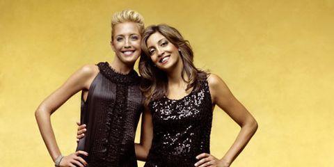 two women posing in black dresses