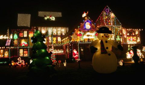 the county of berkshire england is home to this amusing display of christmas lights complete with snowmen a winnie the poohthemed santa and more