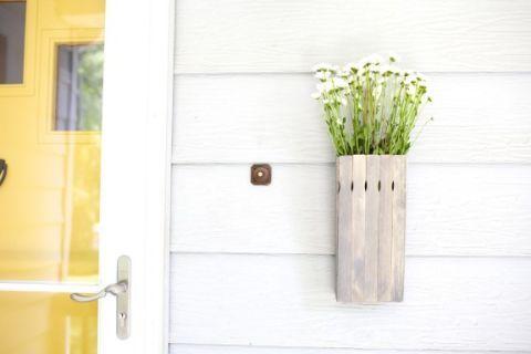 Yellow, Wall, Door, Fixture, Home door, Flowerpot, Household hardware, Grey, Door handle, Vase,