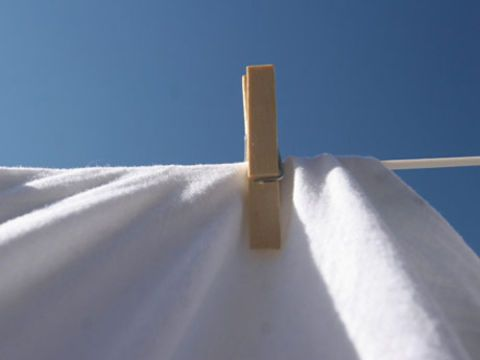 clothespin holding a towel to a clothesline