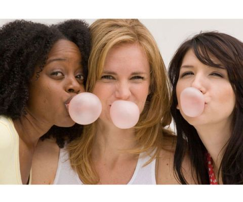 friends chewing gum together
