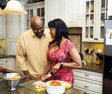 couple in kitchen preparing a meal together