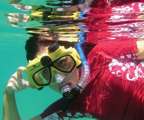 boy underwater wearing digital camera mask